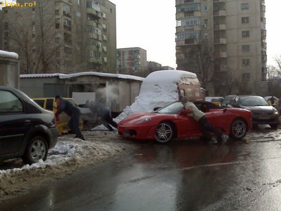 Auto Moto - Un Tico tracteaza un Ferrari